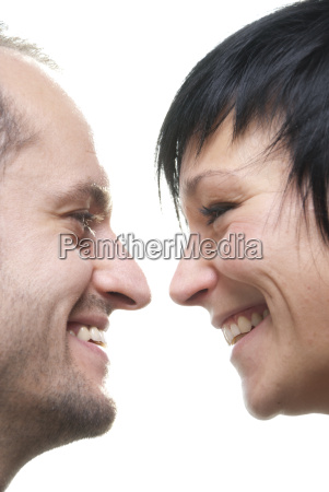 husband and wife laugh next to
