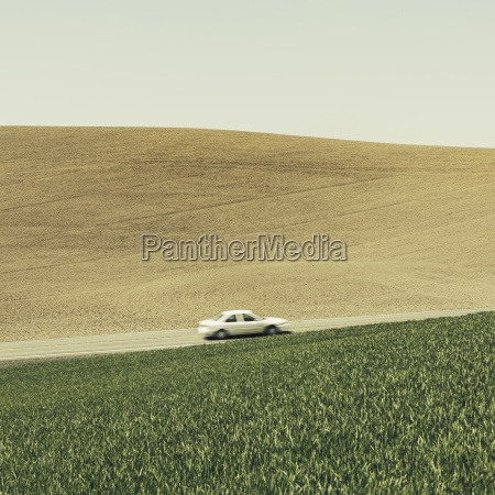 a car driving on am uphill