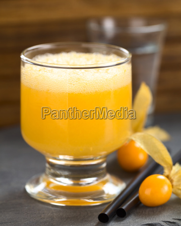 peruvian cocktail called aguaymanto physalis sour