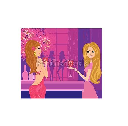 beautiful disco girls with drinks