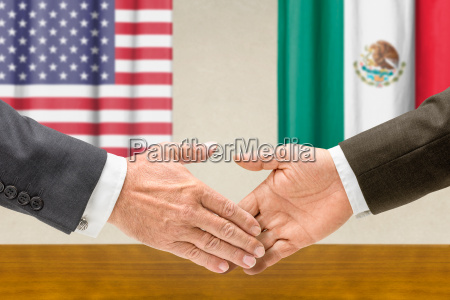 us and mexican officials shake hands