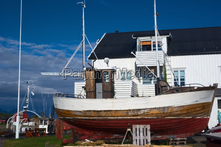 wooden boat on land on the
