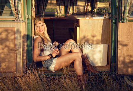 attractive blonde on an old minibus