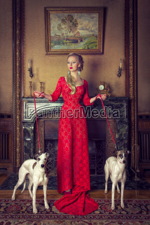 the red lady with two dogs