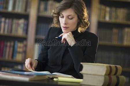 woman desk education macro close up