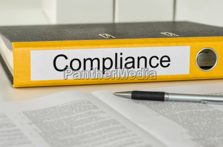 file folder with the label compliance