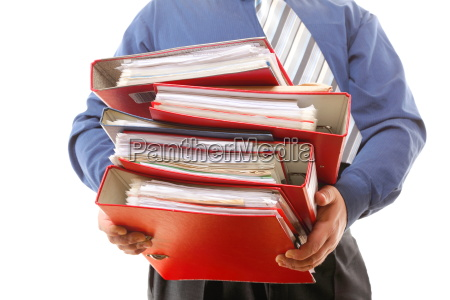 male office worker carrying a stack