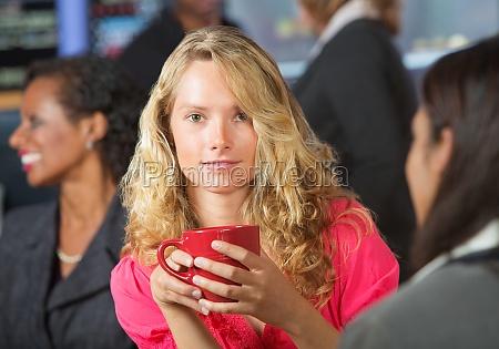 woman with red mug