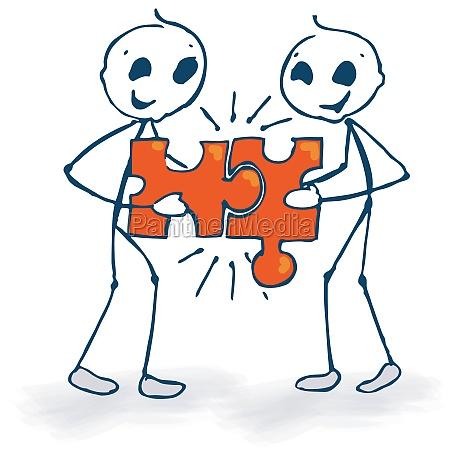 strichmaennchen und puzzle