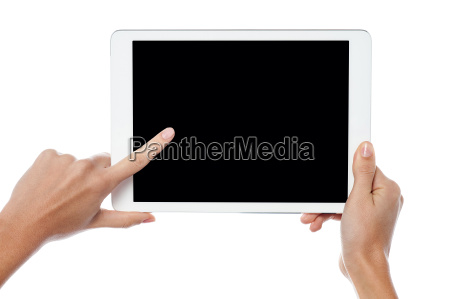 finger being pointed on tablet screen