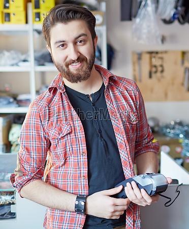 man at the cash register