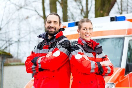 emergency doctor in front of ambulance