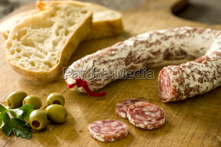 ring salami with baguette and green