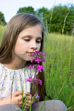 girl child young meadow grass flower