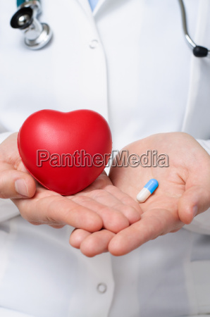 doctor holding a heart and a
