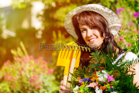 woman in summer garden with flowers