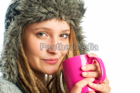 blond girl with fur hat holds