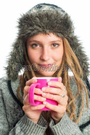 blond girl with fur hat holding