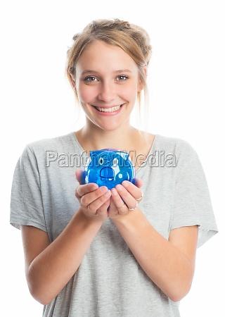blond girl holding a piggy bank