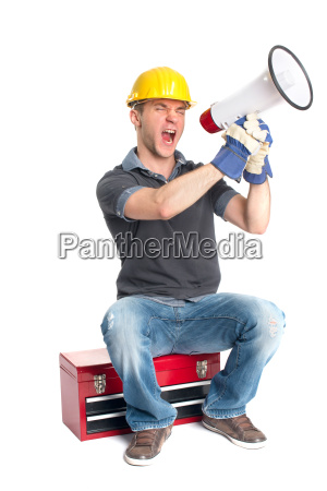 a craftsman sitting on a toolbox