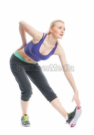 blonde girl makes gymnastics