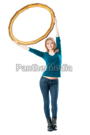 blond girl holding a gold picture