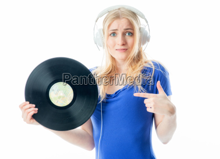 blonde girl with headphones holds a