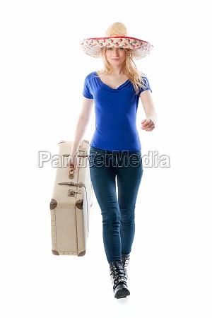 blondes maedchen mit reisekoffer
