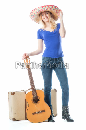 blond girl with suitcase and guitar