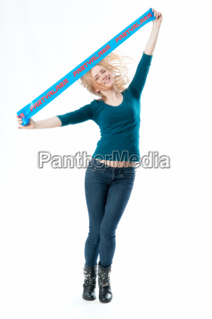 blonde girl holds a banner with
