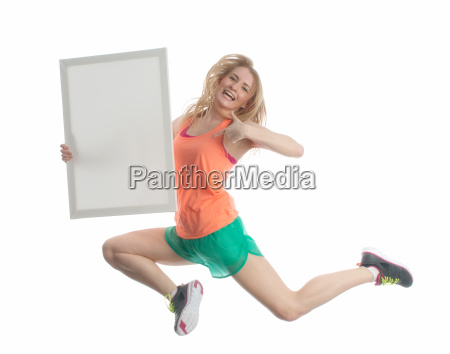 blond sportswoman with advertising sign