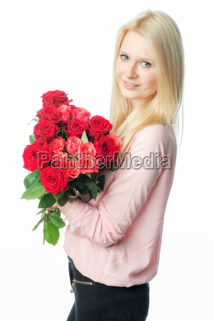 blonde girl with bouquet of roses