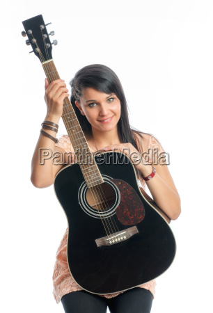 black haired girl with guitar