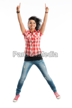 young girl jumping for joy in