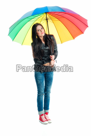 young woman standing under an umbrella