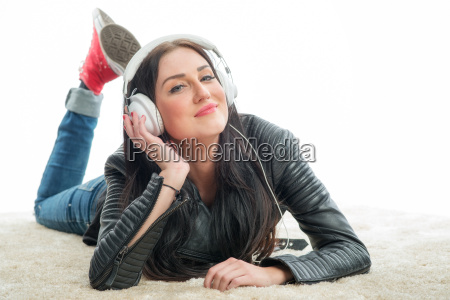 racewoman with headset enjoys music