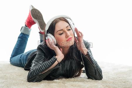 racial woman with headset enjoys music
