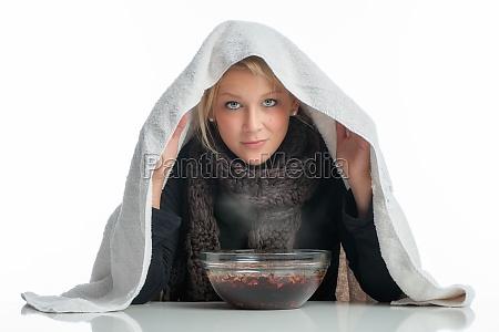 sick woman inhaled through aufgussschale
