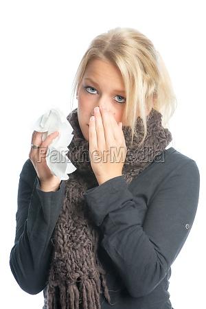 sick blond woman with handkerchief
