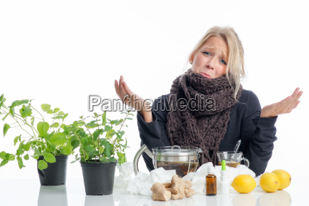 sick blond woman with remedies