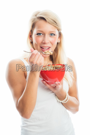 blond woman holding a bowl of