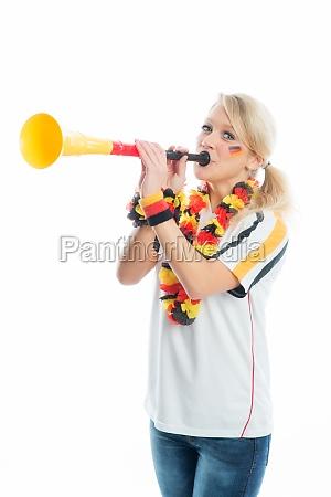 blonde football fan with vuvuzela