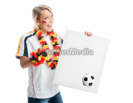 blonde football fan holds a poster