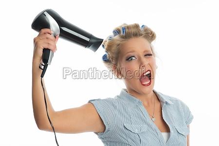 woman blows hair