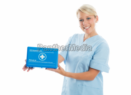 nurse with first aid kit