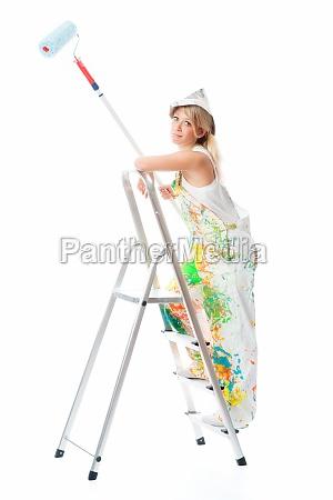 female painter on stepladder