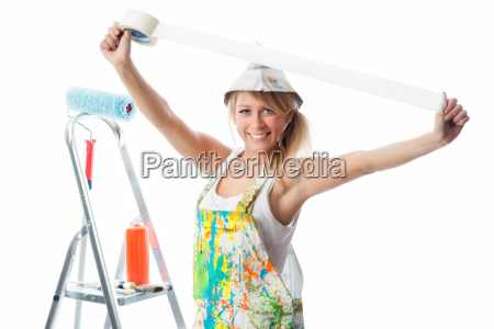 female painter with masking tape
