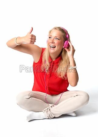 blonde woman with headphones