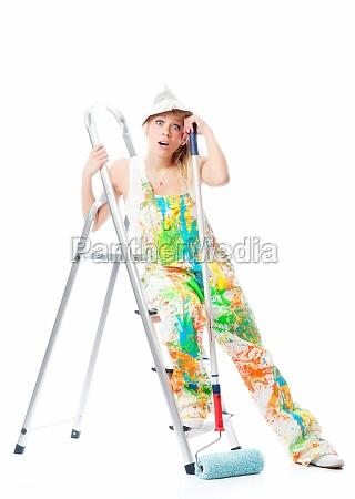 tired painter on stepladder