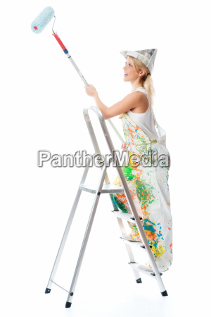 female painter on stepladder